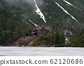 tourist house in the mountains in the background of a frozen mountain lake Morsko oko 62120686