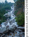 mountain waterfall in the mountains of the high Tatras in Poland 62120698
