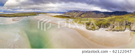 Aerial view of the beach and caves at Maghera Beach near Ardara, County Donegal - Ireland 62122047