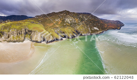 Aerial view of the beach and caves at Maghera Beach near Ardara, County Donegal - Ireland 62122048