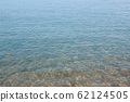 Closeup of calm wavy clear transparent water 62124505