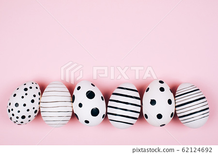 Many easter eggs on pink. Flat lay. 62124692