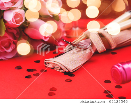 Festive woman, valentine day dinner concept on red 62125546