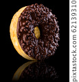 Chocolate donut isolated on a black background with reflection 62139310
