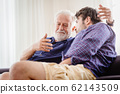 old man serious discussion with younger man indoor, grand father serious talking 62143509
