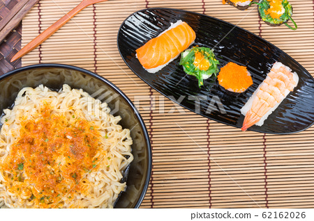sushi and noodle in black dish 62162026
