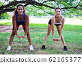Beautiful young sport woman exercise before running and jogging at public park. 62165377