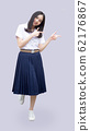 asian girl in Thai university uniform pointing 62176867