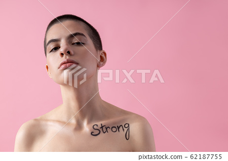 Confident woman with strong sign on her body stock photo 62187755