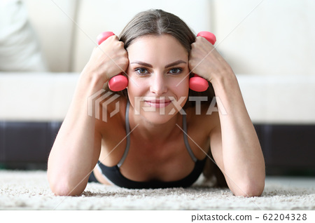Girl learns to correctly perform exercises at home 62204328
