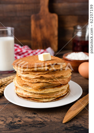 Stack of thin crepes, blini with butter 62207199