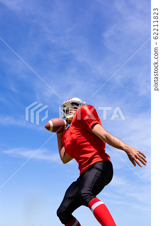 Football player with ball 62211823