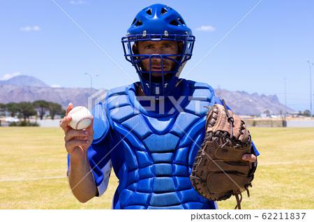 Baseball player with ball and glove 62211837