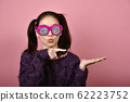 Asian woman hand finger point presenting product for mock-up advertising. 62223752