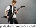 Young man playing electric guitar 62225148