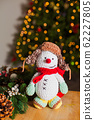 The toy snowman is a wonderful gift for the new year 62227805