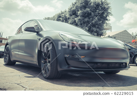 electric car parked in city district 62229015