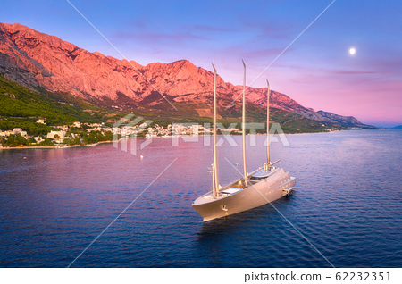 Luxury yacht and blue sea at sunset in summer. Aerial view of big modern sail boat. Top view 62232351