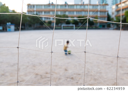 Cute baby boy playing with a soccer ball alone 62234959