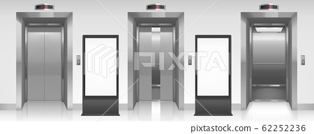 Blank billboards and elevator doors in hallway 62252236
