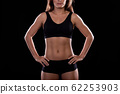 Torso of a girl on a black background 62253903