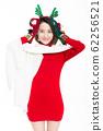 woman wearing reindeer antler holding christmas 62256521