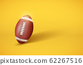 American Football ball on pastel yellow background 62267516
