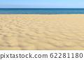 Sand on sandy beach, blue sky and sea, shallow dof 62281180