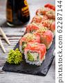Eating Sushi with chopsticks. Sushi roll japanese 62287144