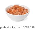 bowl of salt on white background 62291236