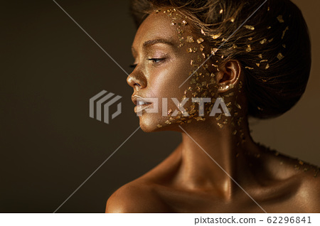 model girl with holiday golden shiny professional makeup. 62296841