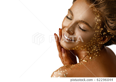 model girl with holiday golden shiny professional makeup. 62296844