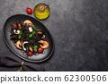 Black seafood spaghetti pasta 62300506