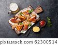 Hot chicken wings and draft beer 62300514