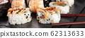 Sushi set close-up panorama with chopsticks on a black background 62313633