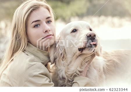 Gentle photo of a woman with a pet 62323344
