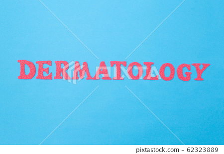 The word dermatology on a blue background. Concept section of medicine dealing with problems and treatment of skin and hair on the head 62323889