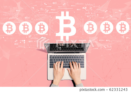 Bitcoin theme with person using laptop 62331243
