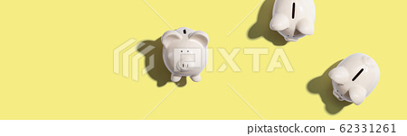 White piggy banks overhead view 62331261
