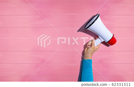 Person holding a megaphone 62331311