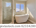 Glossy bathtub and separate shower inside the 62334280