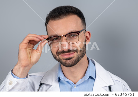 Close up picture of a doctor in eyeglasses 62345751