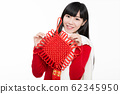 pretty girl holding chinese knot 62345950