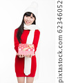 young woman with gifts smiling to the camera 62346052