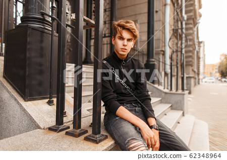 Young vogue handsome stylish man with a hairstyle 62348964