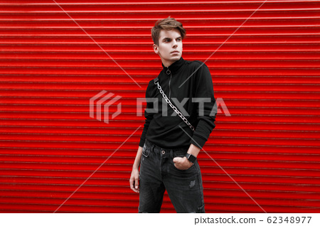Handsome young model man in a black stylish jacket 62348977
