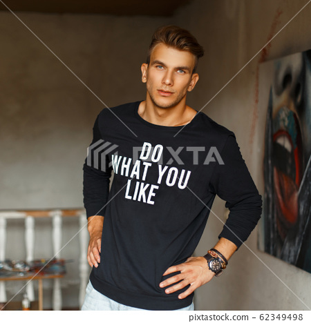 handsome young man in a black pullover with words 62349498