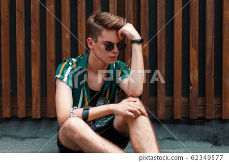 Handsome model guy with sunglasses  62349577