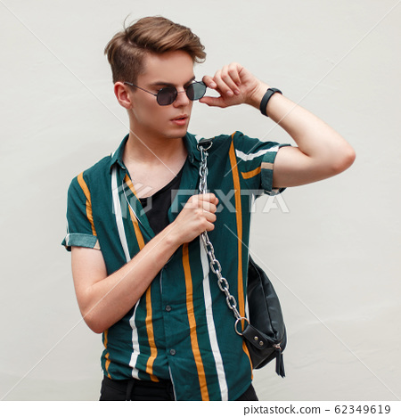 Handsome guy with sunglasses 62349619