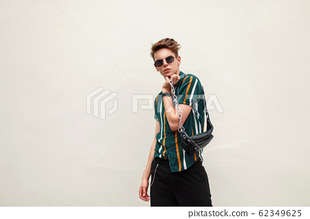 Stylish young handsome man with sunglasses  62349625